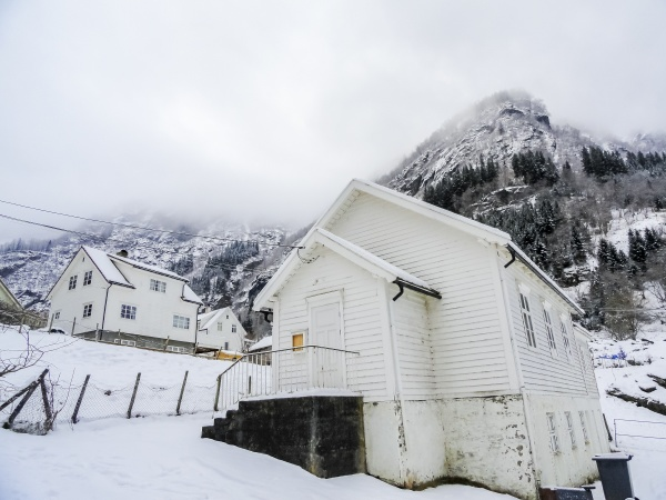 white wooden houses in wintry norway