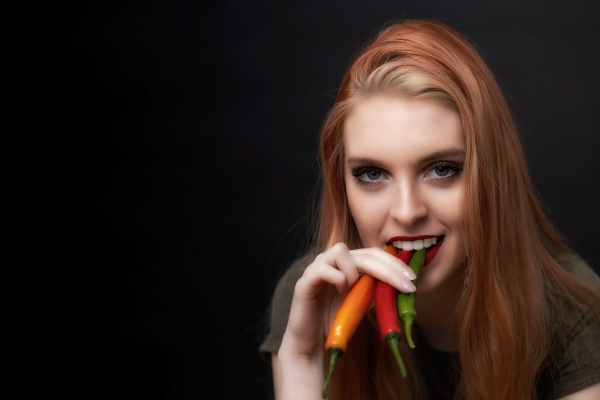 attractive young woman is tasting colorful