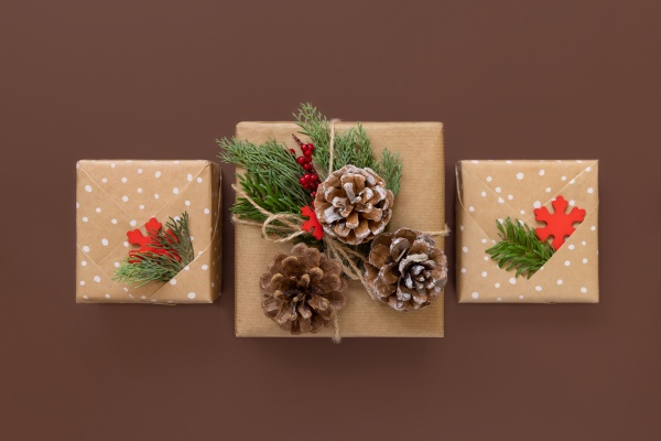 wrapped christmas present on brown background