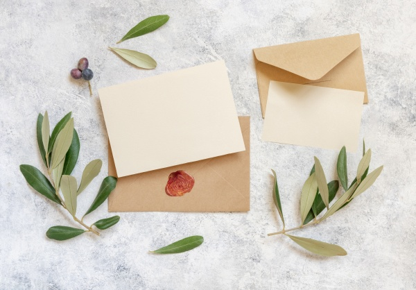 blank cards and envelopes on table