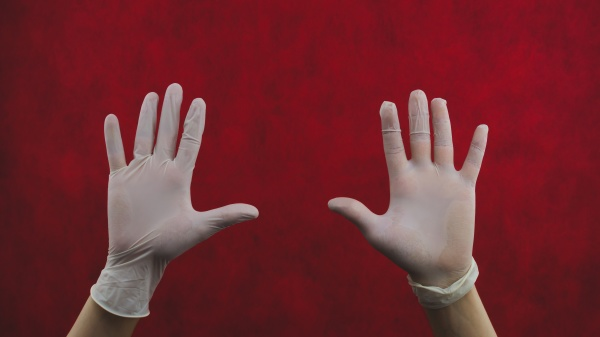 hands in protective gloves on a