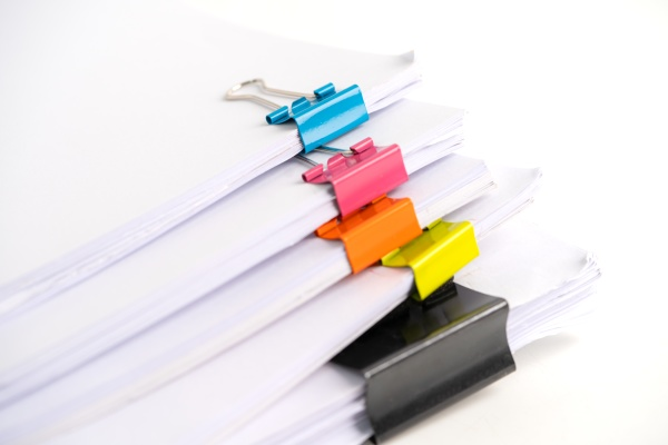 stack of report paper files in
