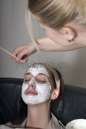 putting on a face mask