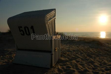 sunset in a beach chair