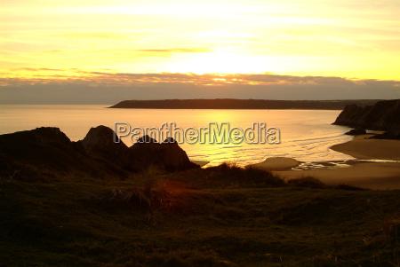 sunset three cliffs