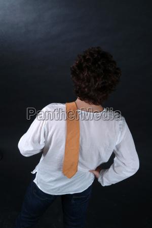 man shouldering tie 1