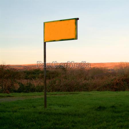 yellow shield in landscape 1