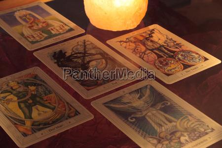 esoteric tarot cards candlelight