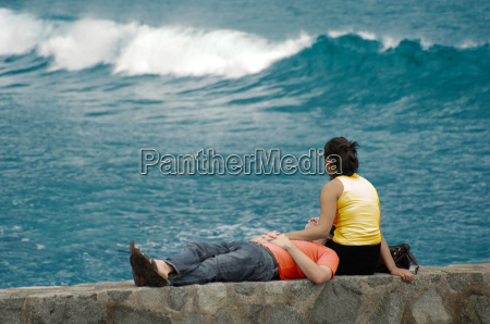 young, couple, sitting, on, quay, wall - 486380