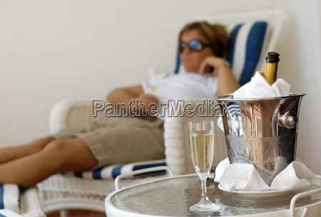 woman, in, deckchair, with, champagne, bucket - 607893