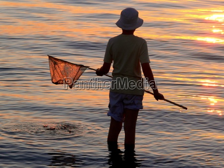 child with fishing net in the