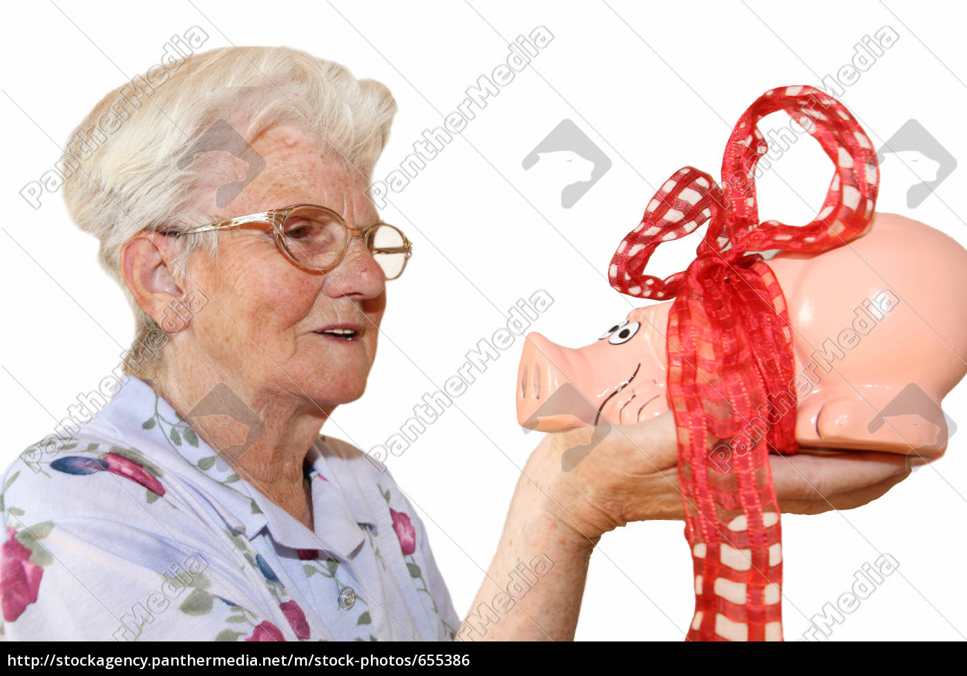 retired, woman, with, piggy, bank - 655386