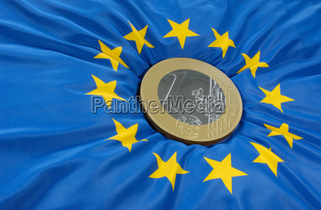 euro, coin, on, the, european, flag - 657212