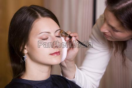 woman, applying, makeup, by, makeup, artist - 718758