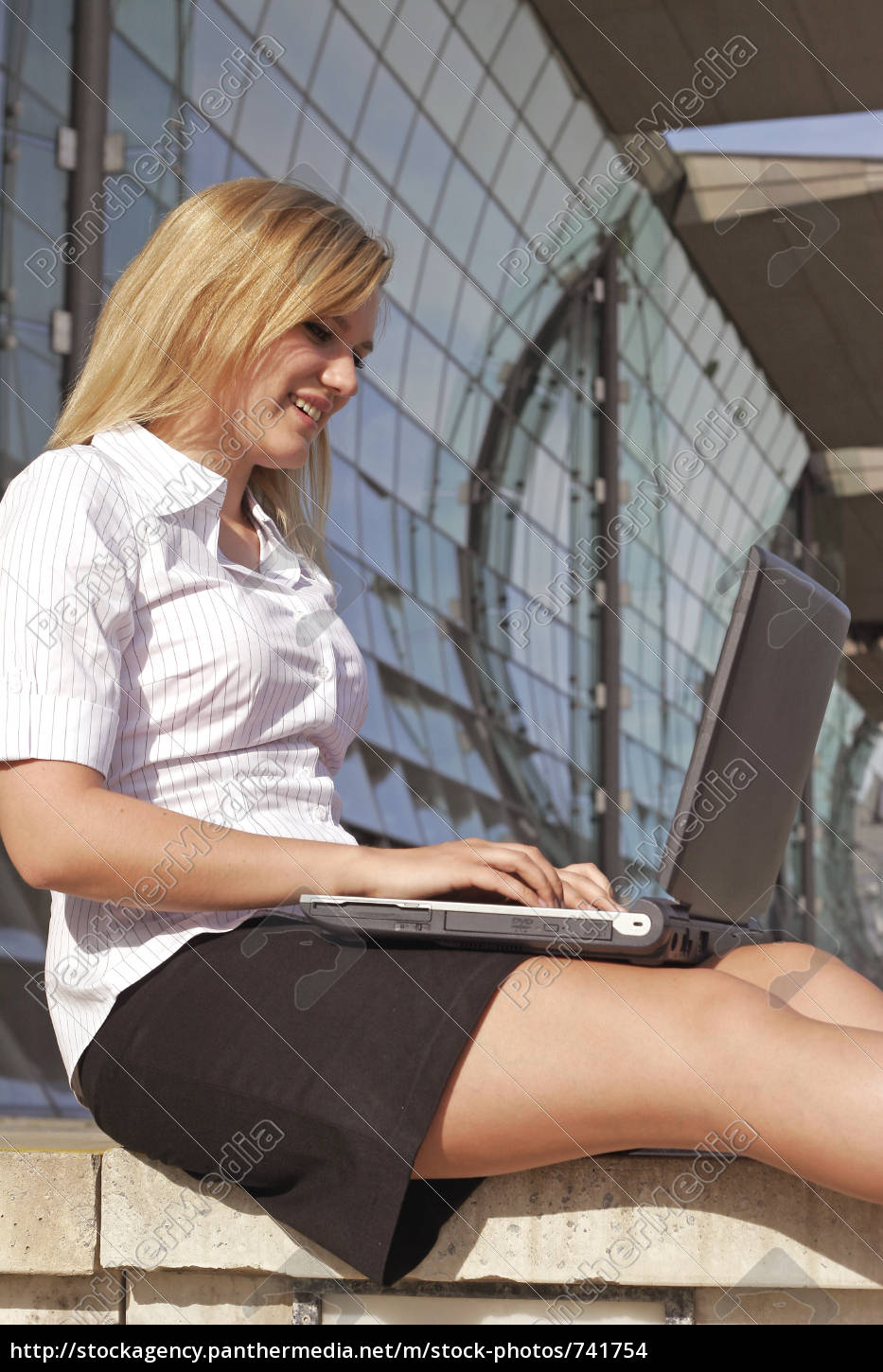 young, woman, sitting, outside, with, laptop - 741754