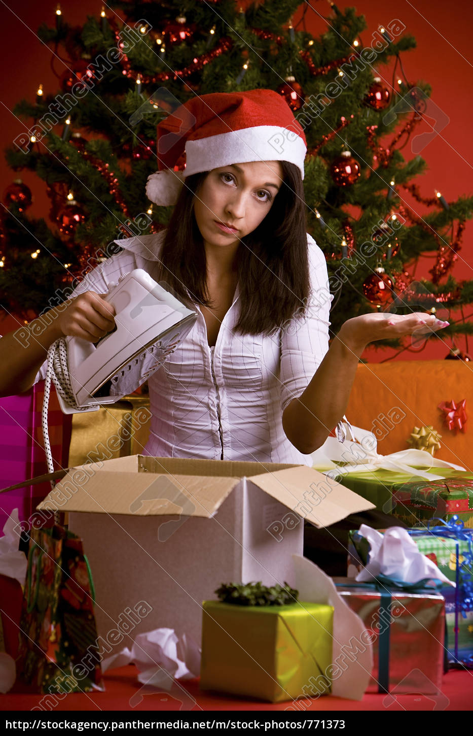 disappointed, woman, with, christmas, present - 771373