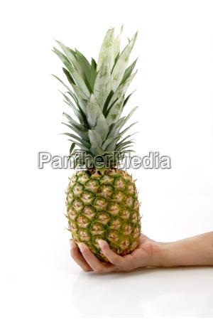 a handful of pineapple