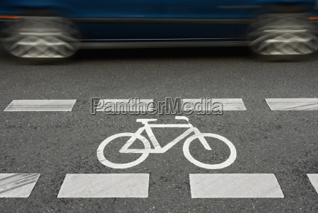 cycle lane with blue car