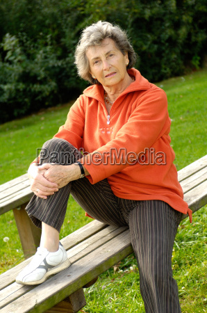 senior on a wooden bench