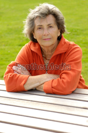 senior woman sitting on a wooden