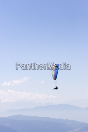 paragliders in front of mountain landscape