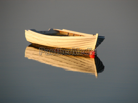 a wooden boat at calm sea