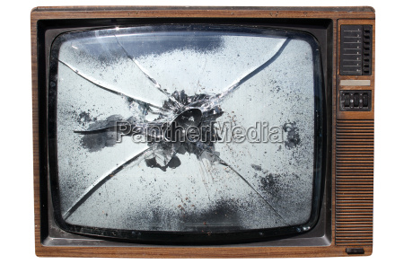 an old trashed tv with a