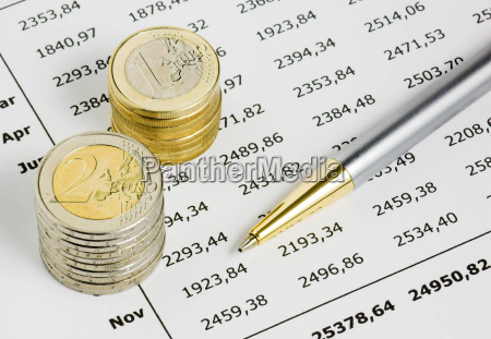pen coins and table