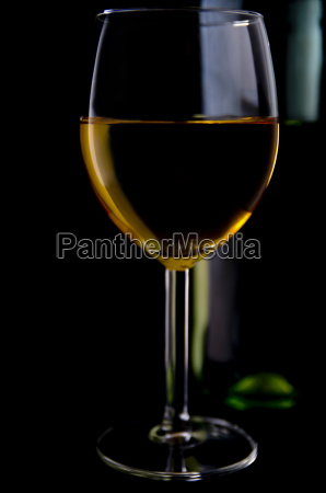 white wine glass with bottle