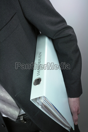 businessman with folder properties