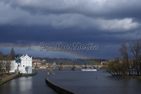 charles bridge under the rainbow