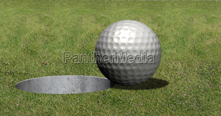 golf ball in front of hole