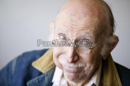 senior man in a jacket
