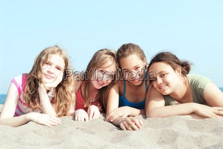 four, girls, on, a, beach - 1203967