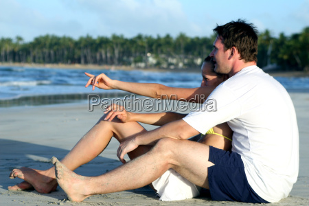 loved up couple on the beach
