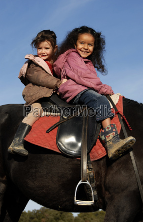 two, riding, little, girls - 1266713
