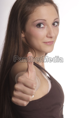 woman showing thumbs