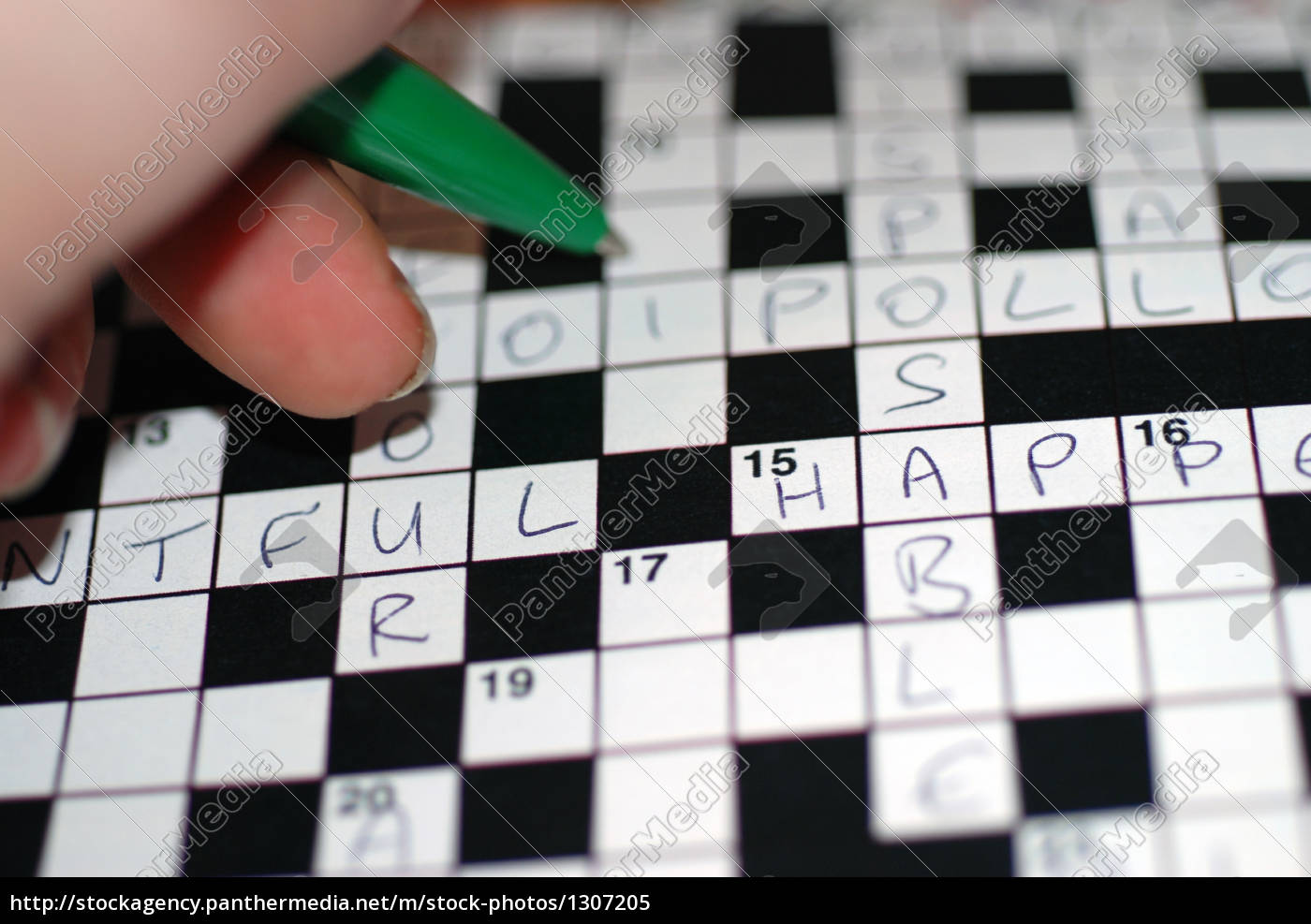 filling, in, a, crossword, puzzle - 1307205