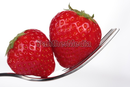 a couple of strawberries on a