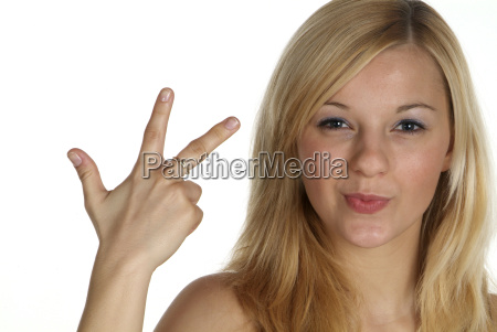 woman showing three