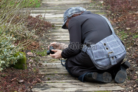 kneeling photographer