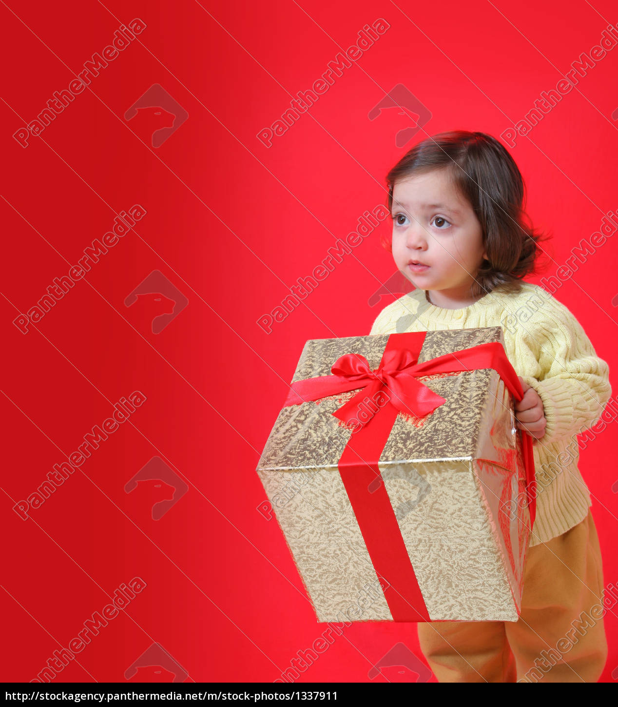 toddler, with, a, christmas, gift - 1337911