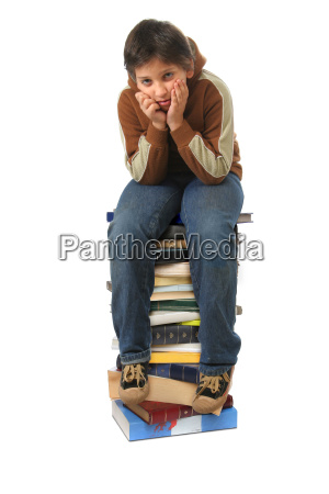 student, sitting, on, a, pile, of - 1338157