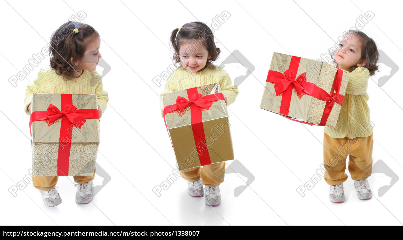 toddler, with, a, christmas, gift - 1338007
