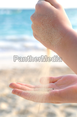 hands, pouring, sand, on, a, beach - 1346753