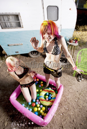 women, splashing, in, a, play, pool - 1353641