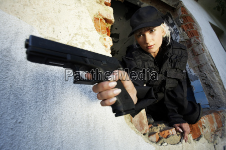 young, policewoman, in, action - 1359219