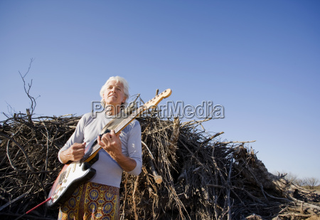 electric guitar player outdoors
