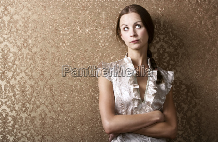 young, woman, leaning, against, a, wall - 1363765