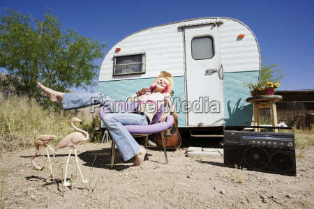 woman, in, front, of, travel, trailer - 1373963